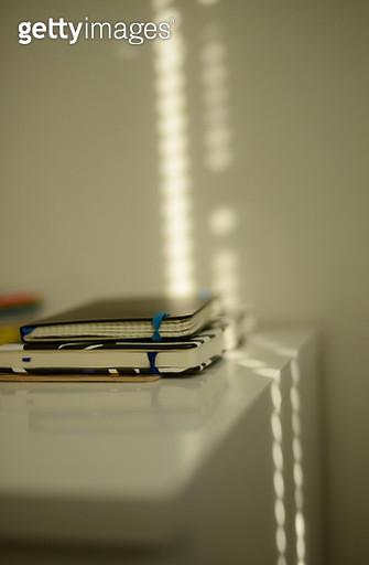 two notebooks on a white shelf in a lovely sunlight - gettyimageskorea