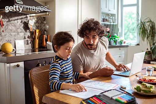 Father helping his son with schoolwork - gettyimageskorea
