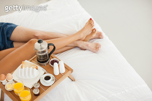 Couple having breakfast in bed - gettyimageskorea