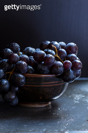 Bowl of juicy ripe black grapes - gettyimageskorea