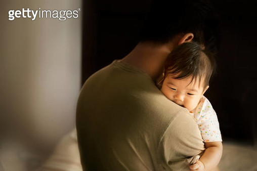 Asian toddler carried by father in moody bedroom background. Bonding time. - gettyimageskorea