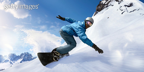Fast Moving Snowboarder In Motion Close Up During Turn - gettyimageskorea