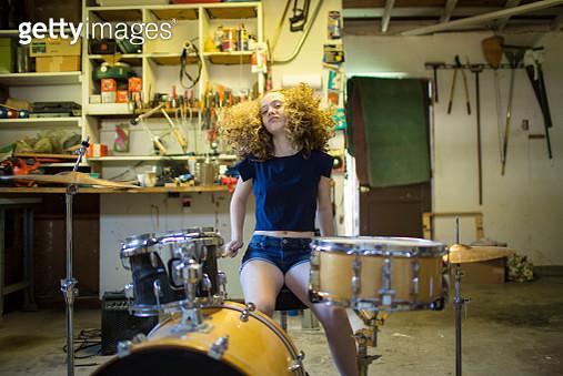 Teenage drumming in old garage. - gettyimageskorea