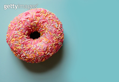 Colourful donut on a blue table - gettyimageskorea