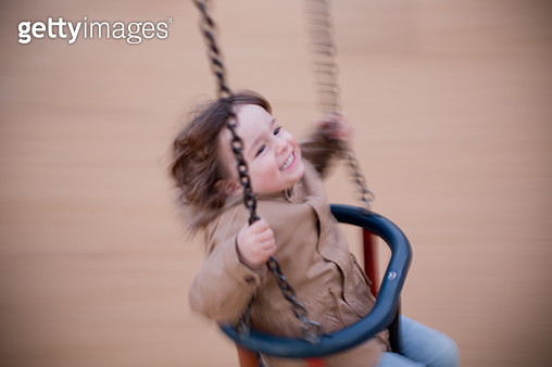 Todler having a great time in the swing - gettyimageskorea