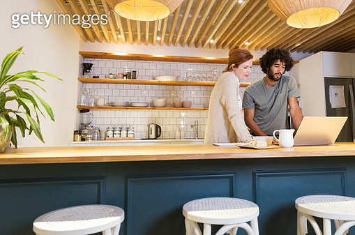 Creative business people having informal meeting in office kitchen - gettyimageskorea