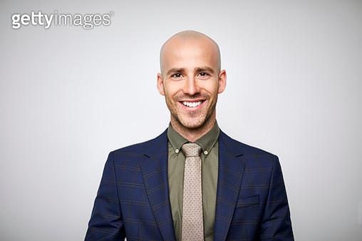 Smiling bald businessman wearing navy blue suit - gettyimageskorea