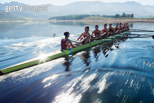 Rowing team rowing scull on lake - gettyimageskorea
