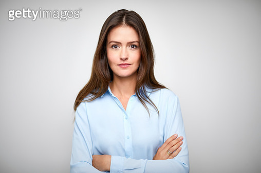 Female white collar worker with arms crossed - gettyimageskorea
