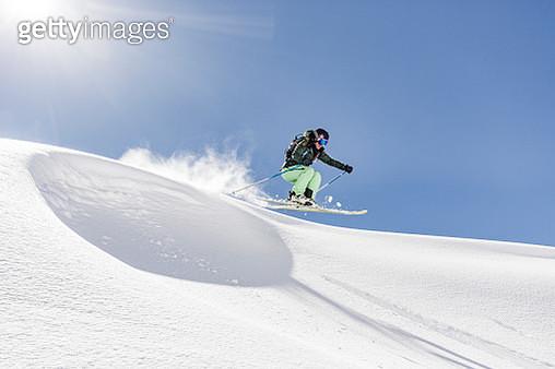 Female skier jumping - gettyimageskorea