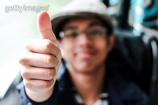 Boy Showing Thumbs Up Sign - gettyimageskorea