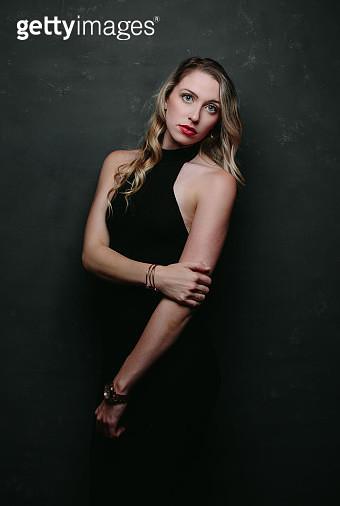 Blonde model on dark background - gettyimageskorea