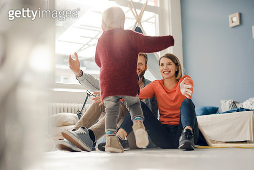 Happy family playing with their son at home - gettyimageskorea