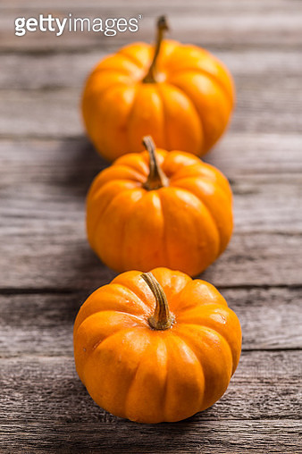 Close-up of pumpkins on wooden table - gettyimageskorea