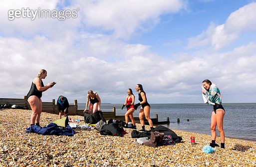 Women smiling after open water swimming - gettyimageskorea