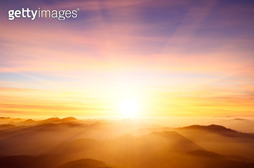 sunset over mountains - gettyimageskorea