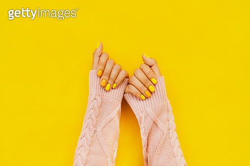 Woman in sweater with colorful manicure. Trending bright backdrop of the year. Perfect nails concept - gettyimageskorea