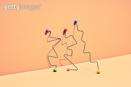still life with sticks and colored marbles symbolizing balance and choice - gettyimageskorea