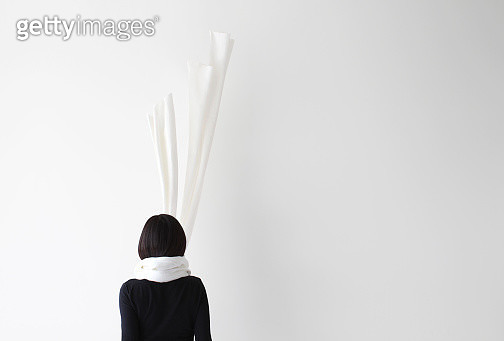 Rear view of a woman with her scarf floating up - gettyimageskorea