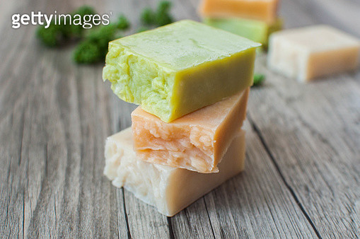 Varieties of organic soap on a rustic wooden table - gettyimageskorea