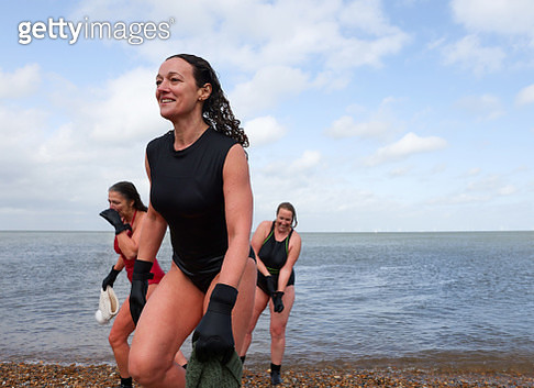 Women come out of the water after open water swimming - gettyimageskorea
