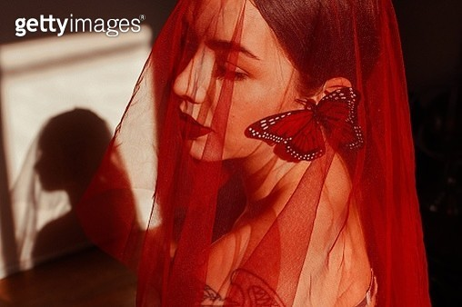 Close-Up Of Beautiful Young Woman In Red Scarf During Sunny Day - gettyimageskorea
