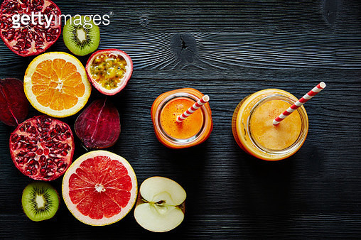 Close-Up Of Smoothie In Jars With Fruits On Table - gettyimageskorea