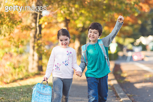 Elementary age students walk to school together - gettyimageskorea