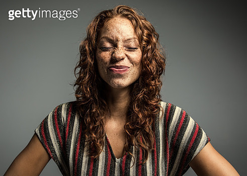 Studio portrait of woman with freckles - gettyimageskorea