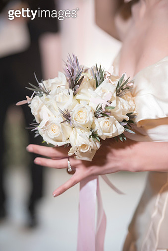Midsection Of Bride Holding Bouquet - gettyimageskorea