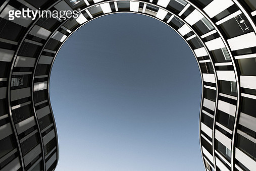 Low Angle View Of Modern Building Against Clear Sky - gettyimageskorea