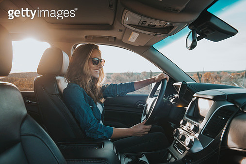 Young Female Driver Sitting in Drivers Seat - gettyimageskorea