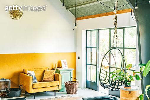 Interior of a Scandinavian, loft style, eclectic, boho living-room. - gettyimageskorea