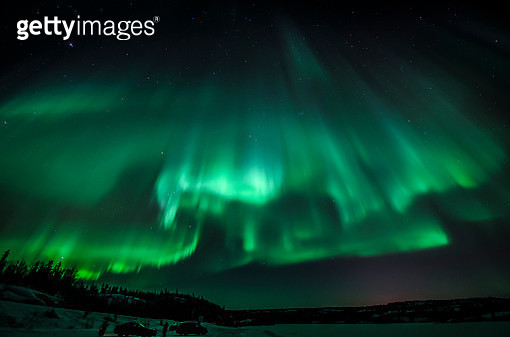 Onlookers at Prosperous Lake with the Aurora Overhead - gettyimageskorea