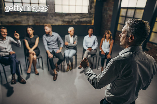 Back view of mid adult coach having group therapy with business people. - gettyimageskorea