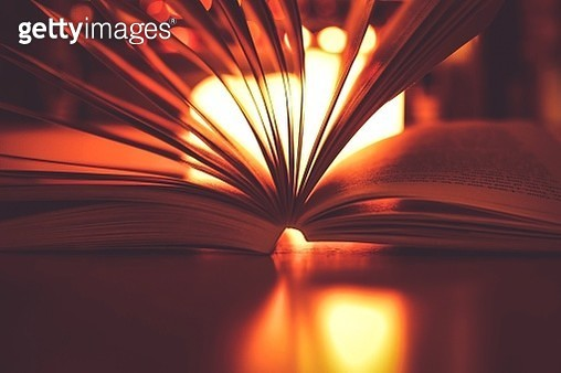 Close-Up Of Open Book On Table Against Fireplace - gettyimageskorea