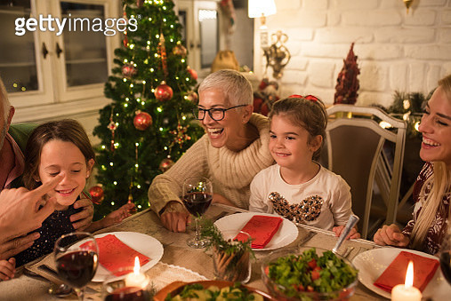 Girls celebrating New Year's eve with family - gettyimageskorea