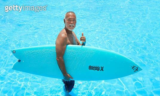 Legendary surfer smiling on rooftop pool - gettyimageskorea