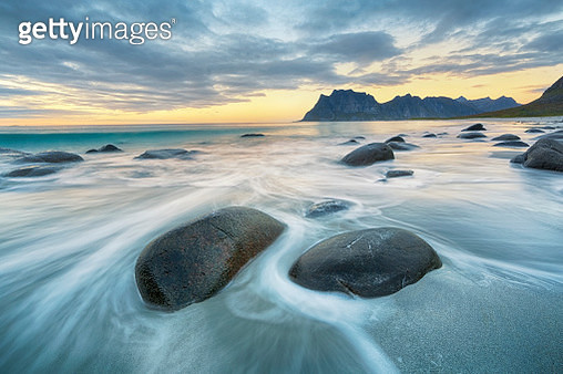 Lofoten is an archipelago and a traditional district in the county of Nordland, Norway. Lofoten is known for a distinctive scenery with dramatic mountains and peaks, open sea and sheltered bays, beaches and untouched lands. - gettyimageskorea