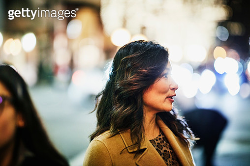 Portrait of mature woman shopping downtown during holidays - gettyimageskorea