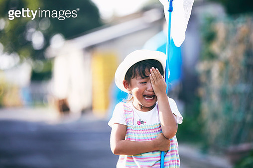 Girl crying with butterfly net - gettyimageskorea