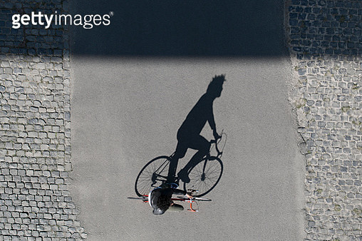 Top view of man riding bicycle - gettyimageskorea