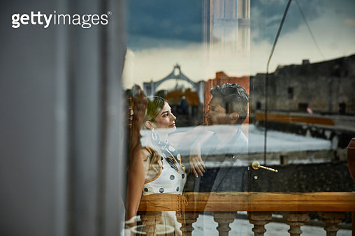 View through window of couple embracing - gettyimageskorea