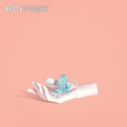 "Blue origami bird with floral pattern and white mannequin hand illustrating the concept of risk and reward ""Bird in the hand"" idiom. - gettyimageskorea"