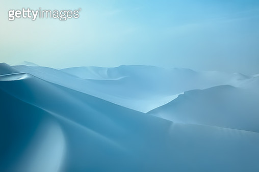 Snow covered desert sand dunes in winter - gettyimageskorea