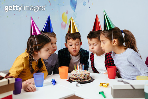 Blowing out birthday candles - gettyimageskorea