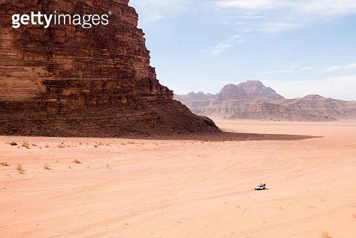 Tourists explore the vastness of the Wadi Rum desert in Jordan. - gettyimageskorea