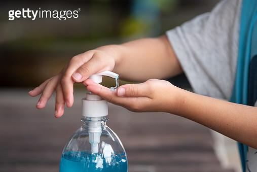 Child Hands Using Wash Hand Sanitizer Gel Pump Dispenser, Selected Focus - gettyimageskorea