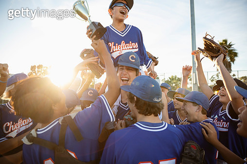 Excited baseball team with trophy celebrating - gettyimageskorea