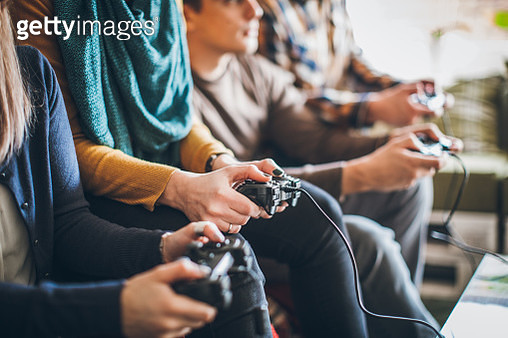 Group of young happy friends playing video games at home. - gettyimageskorea